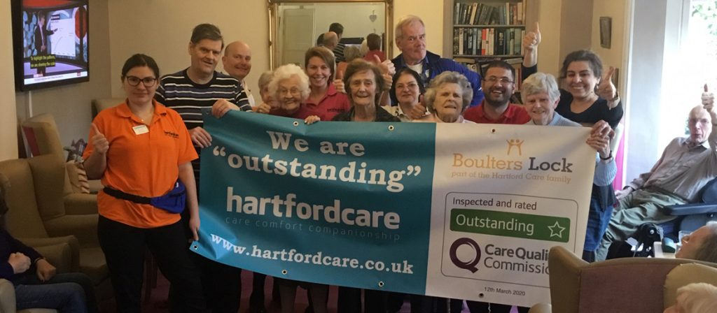 Boulters staff and residents celebrating Outstanding CQC rating