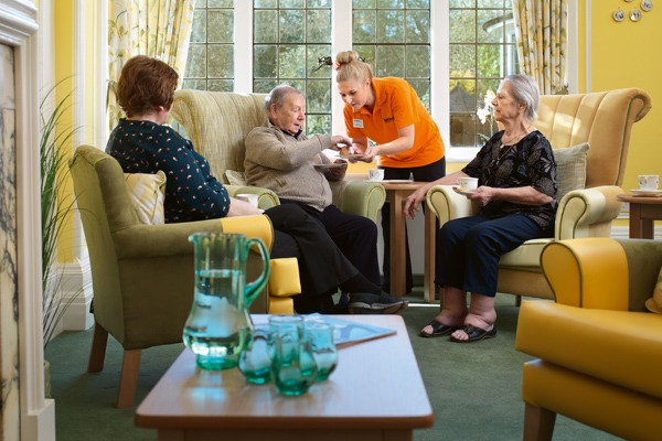 residents sitting comfortably enjoying afternoon tea