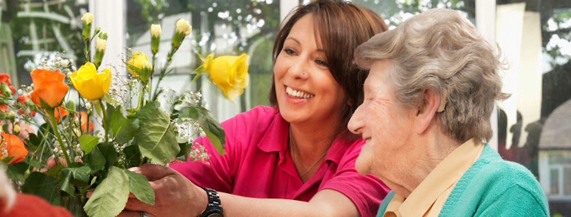 Resident and Care assistant flower arranging