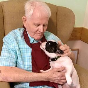 Resident Hugging a dog