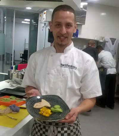 Chef presenting pureed food during training day