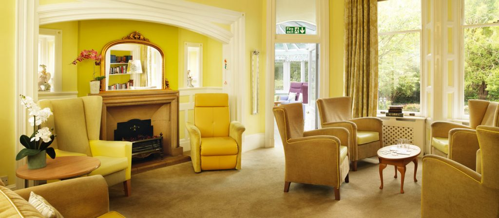Soft yellow lounge area with comfortable chairs